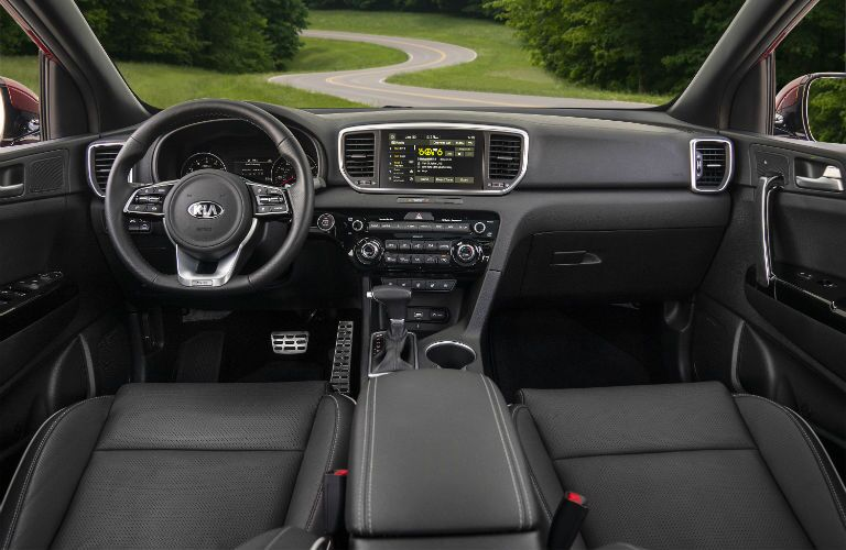 A photo of the front seats and dashboard in the 2021 Kia Sportage.