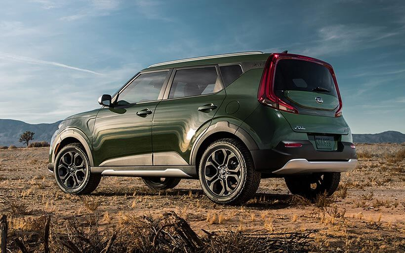 2020 Kia Soul exterior side shot parked on a dry desert plain with a dark green paint color