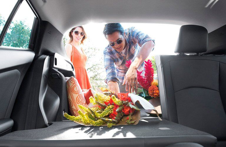 Man and women loading flowers into 2017 Toyota Prius