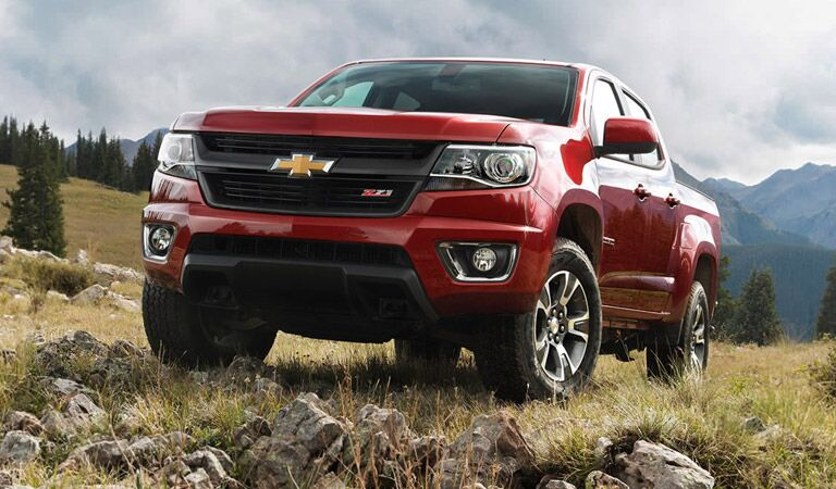 Red Chevy Colorado by mountains