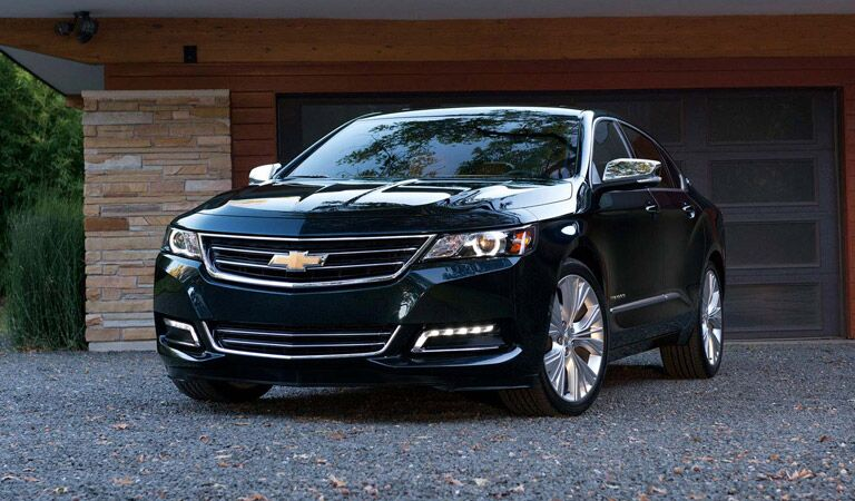 Black Chevy Impala sedan just out of the garage