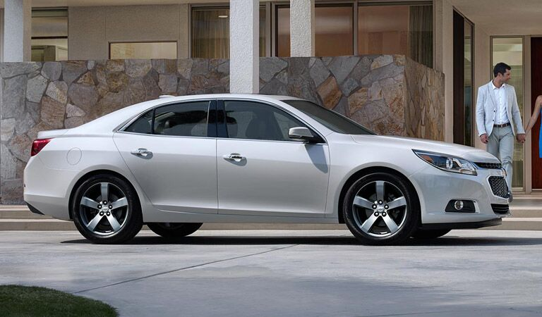 White Chevy Malibu waiting outside a hotel