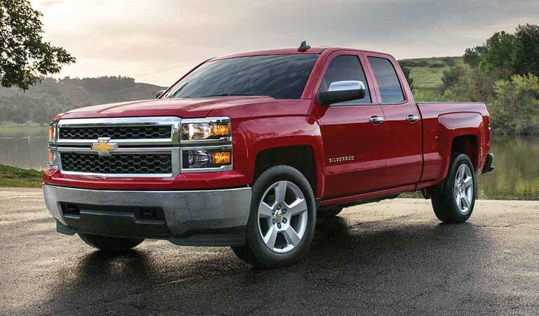 Red Chevy Silverado 1500 among fields