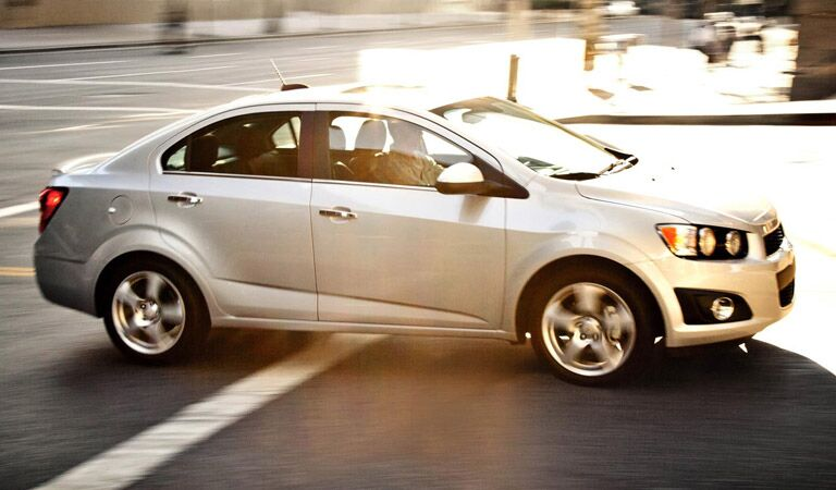 White Chevy Sonic in the city