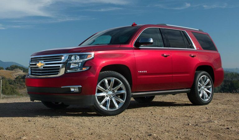 Red Chevy Tahoe off-road in the desert