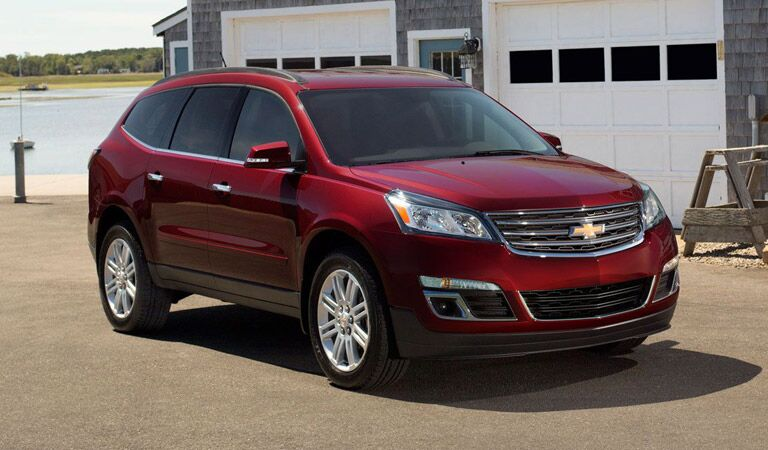 Red Chevy Traverse by the water