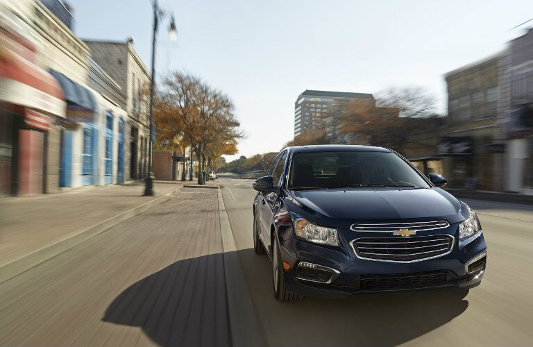 2015 Chevy Cruze driving down a city street