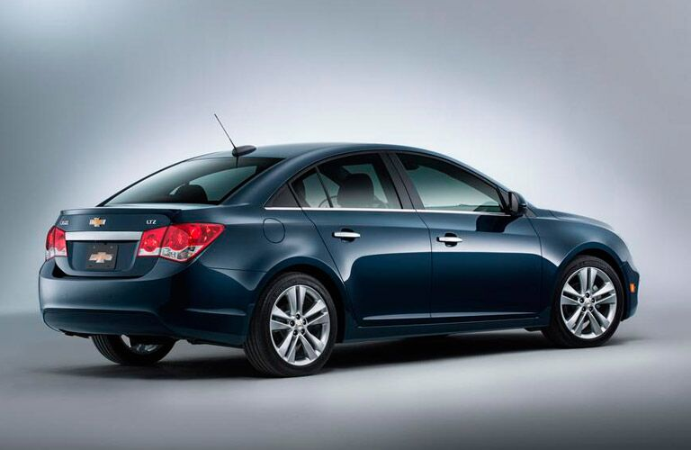 2015 Chevy Cruze from the side on a grey background