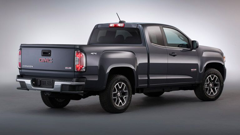 2015 GMC Canyon from the rear against a grey field