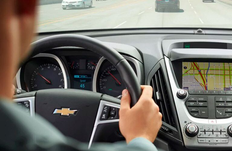 person holding a steering wheel properly in a 2017 Chevy Equinox winnipeg, mb