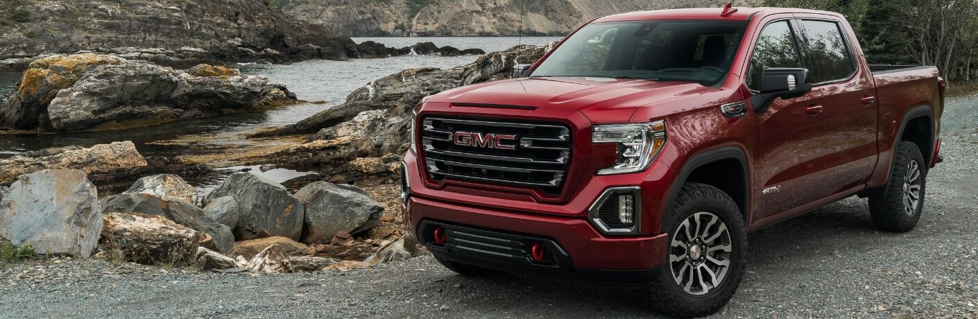 Red 2019 GMC Sierra AT4 in front of rocks