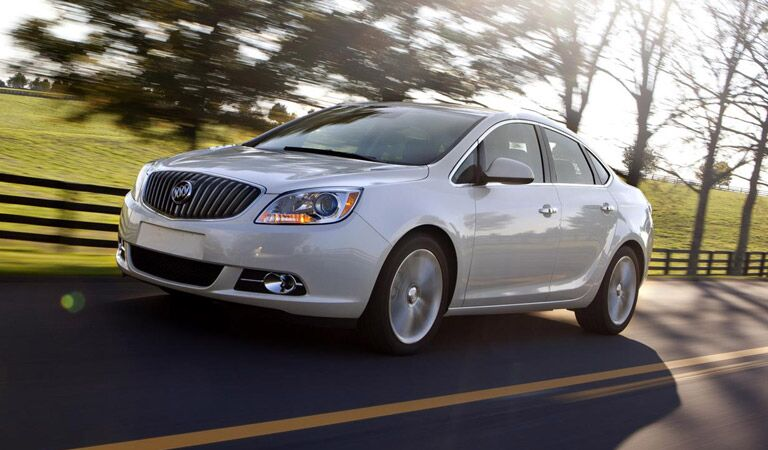 White Buick Verano driving in the country