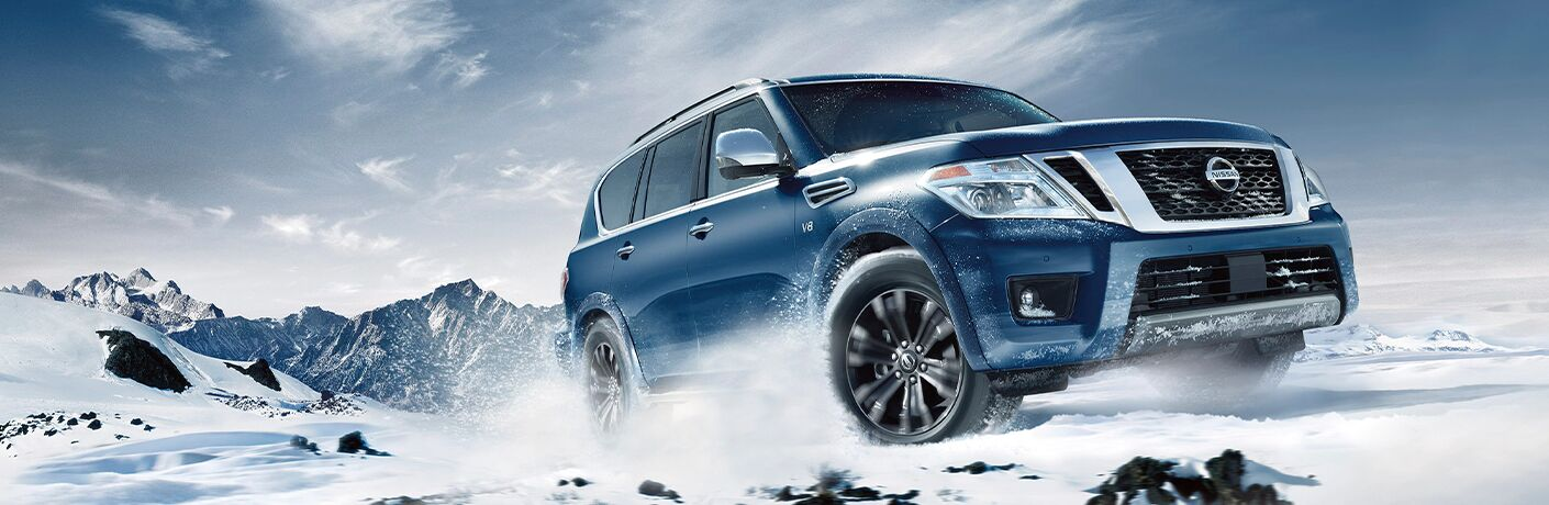 2020 Nissan Armada climbing up a snowy mountain