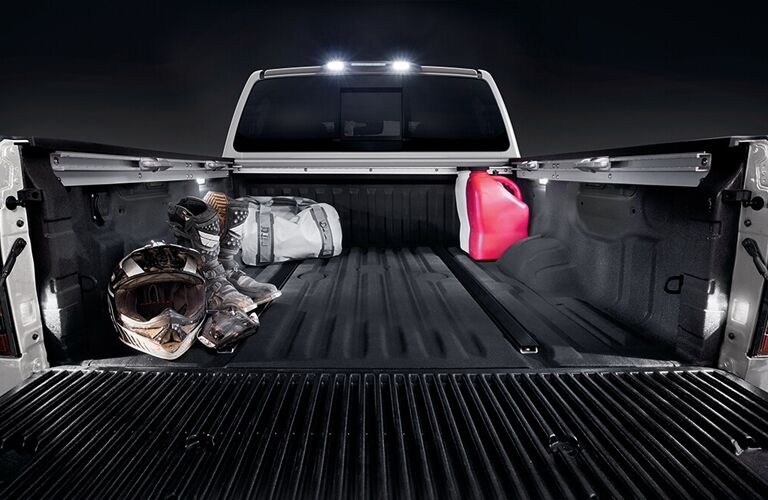 2020 Nissan TITAN bed loaded with a couple of items
