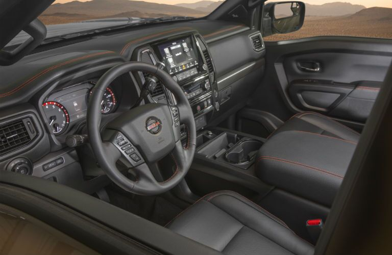A photo of the driver's cockpit and dashboard in the 2021 Nissan Titan.