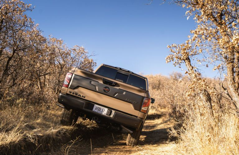 A photo of the 2021 Nissan Titan crossing uneven road.