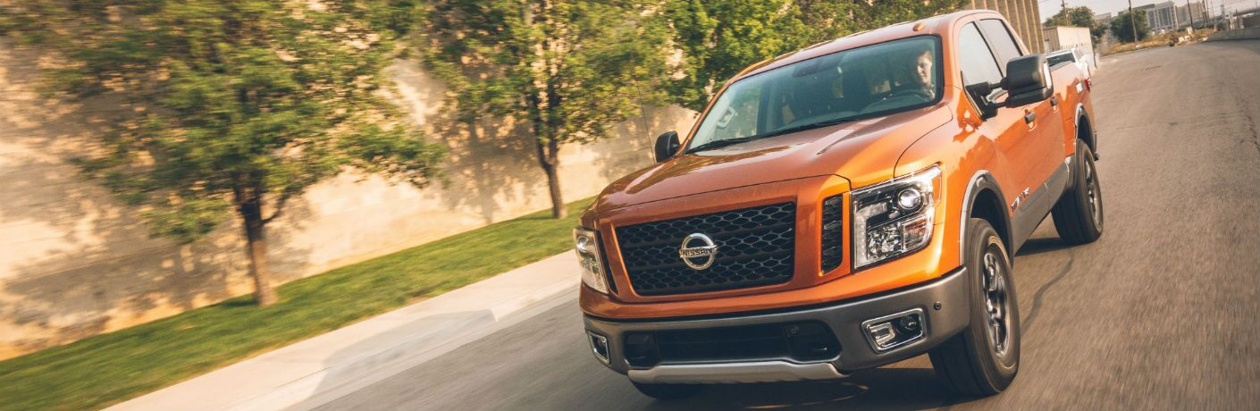 A head-on photo of the 2019 Nissan Titan on the road.