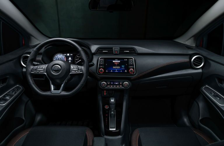 A photo of the driver's cockpit and the dashboard in the 2021 Nissan Versa.