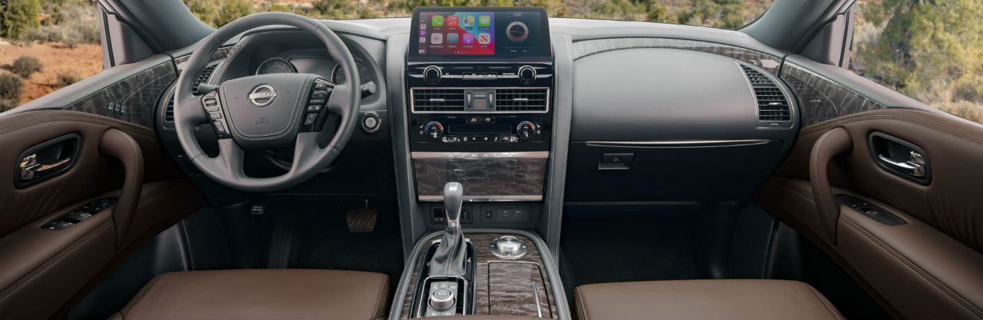 A photo of the dashboad and driver's cockpit in the 2021 Nissan Armada.