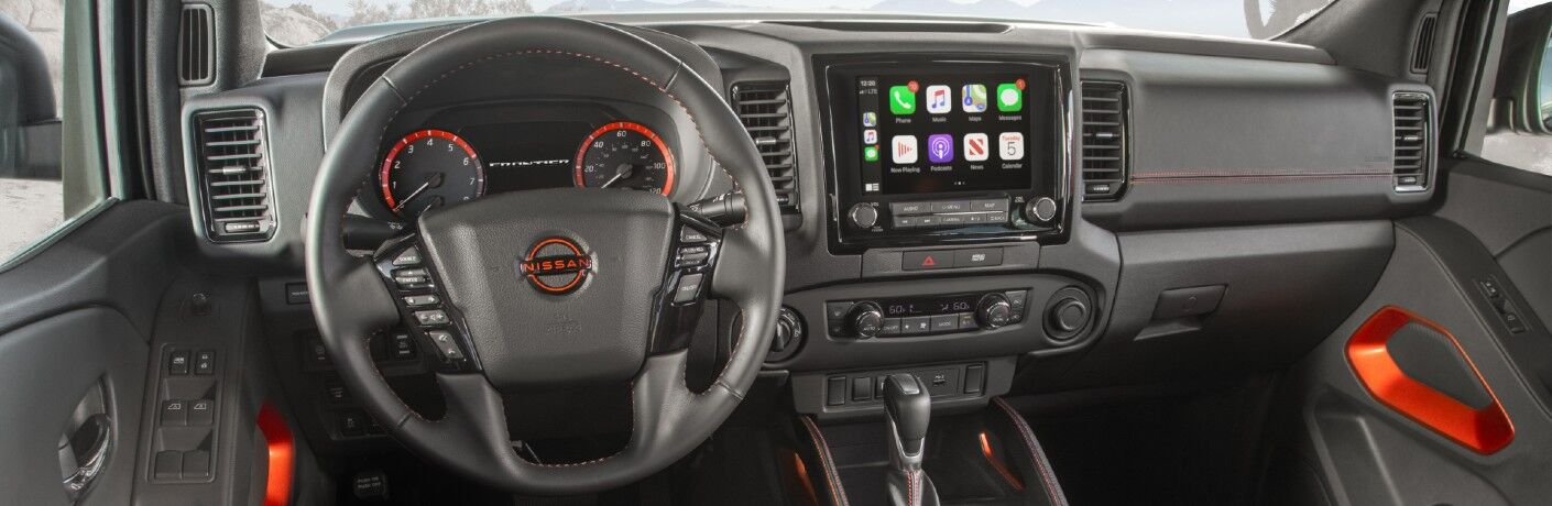 A photo of the driver's cockpit and the dashboard in the 2022 Nissan Frontier.