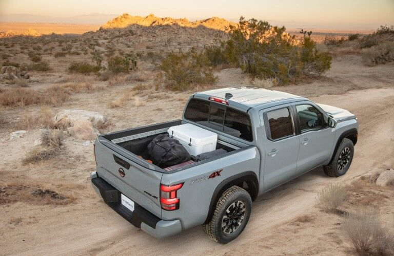 A photo of the 2022 Nissan Frontier with a cargo bed full of cargo.
