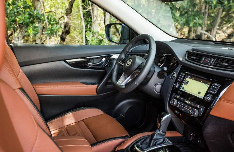 An interior photo showing the driver's cockpit in the 2018 Rogue including the infotainment system