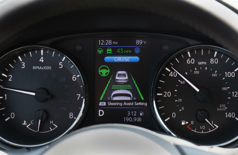 A close up photo of the driver's information screen in the center gauge cluster in the 2018 Rogue.