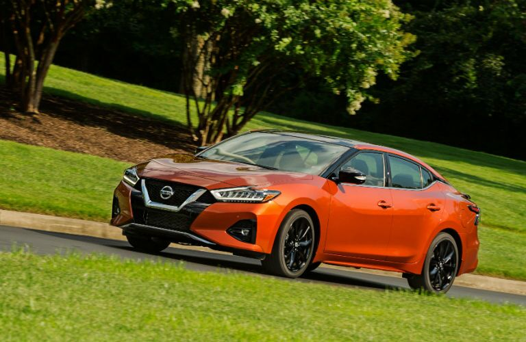A left quarter photo of the 2020 Nissan Maxima on the road.
