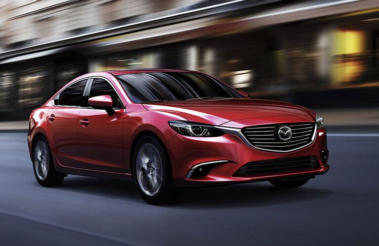 Mazda Mazda6 midsize sedan in red on the city streets