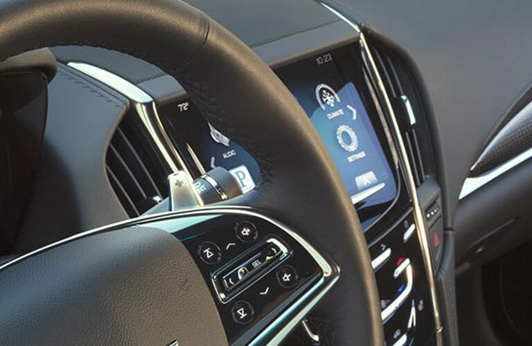 steering wheel and view of the CUE in the 2016 Cadillac ATS Alexandria MN