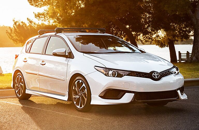 White 2017 Toyota Corolla iM at the Lake