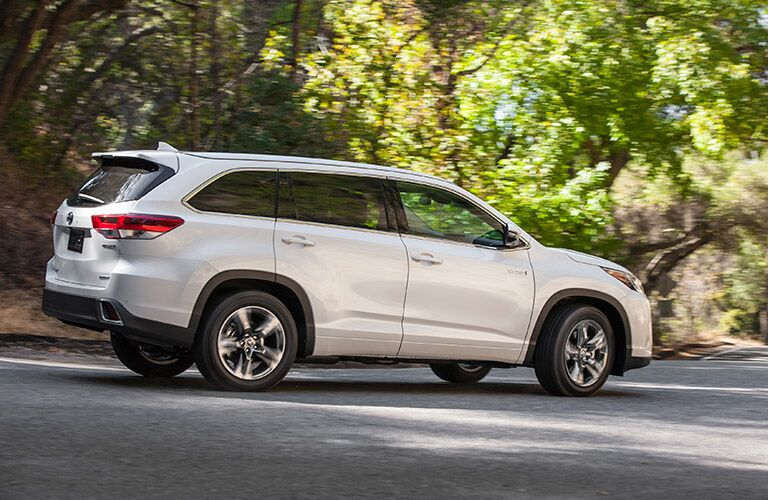 White 2017 Toyota Highlander Hybrid Side Exterior on Forest Road