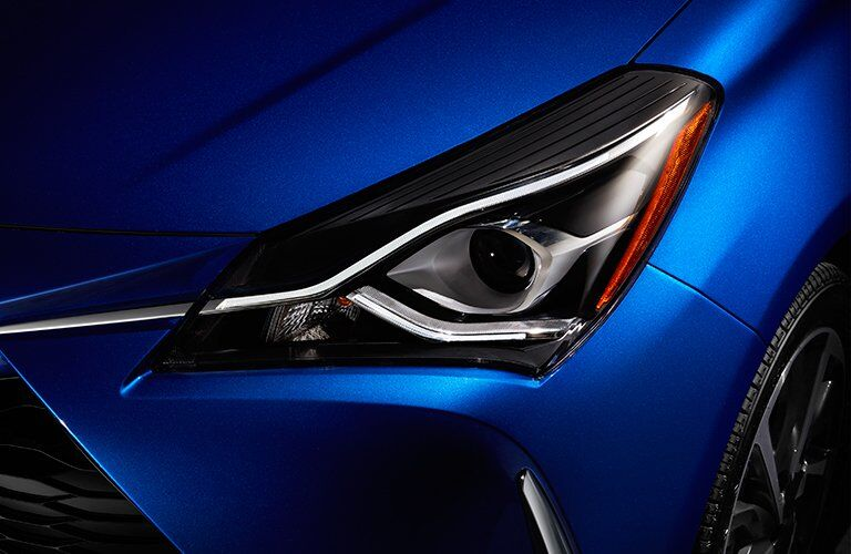 Close Up of 2018 Toyota Yaris Headlight with blue Exterior