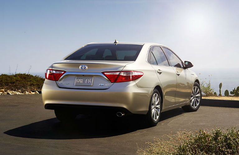 Gold 2017 Toyota Camry Hybrid Rear Exterior at Beach Overlook