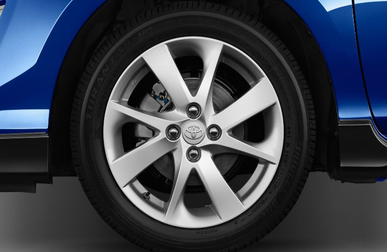 Close Up of 2017 Toyota Prius c Wheels with blue Exterior