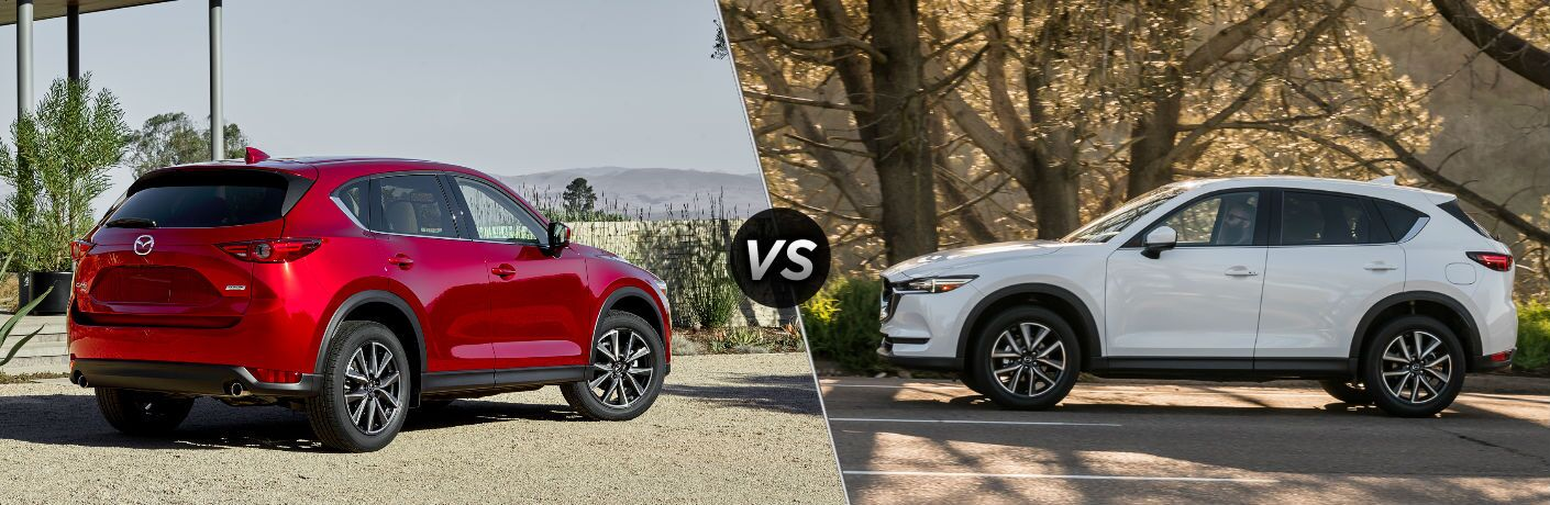 "Rear passenger side exterior view of a red 2018 Mazda CX-5 on the left ""vs"" driver side exterior view of a white 2017 Mazda CX-5 on the right"