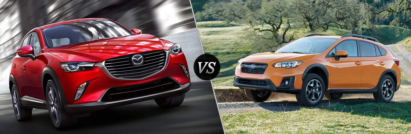 "Front exterior view of a red 2018 Mazda CX-3 on the left ""vs"" Side exterior view of an orange 2018 Subaru Crosstrek on the left"