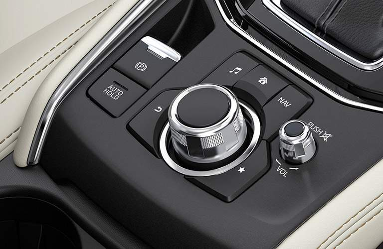 Push-button parking brake and audio controls of the 2018 Mazda CX-5