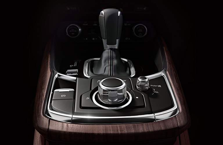 Leather-wrapped shift knob and center console controls of the 2018 Mazda CX-9