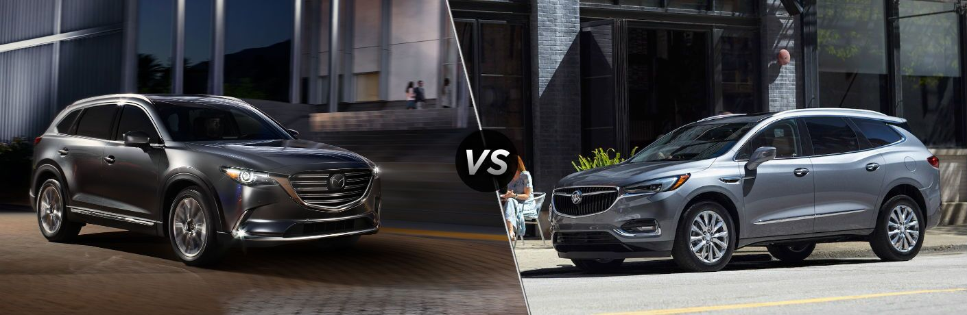"Passenger side exterior view of a gray 2018 Mazda CX-9 on the left ""vs"" driver side exterior view of a gray 2018 Buick Enclave on the right"