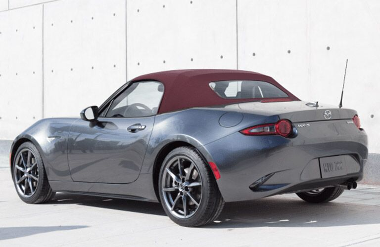 Rear exterior view of a gray 2018 Mazda MX-5 Miata