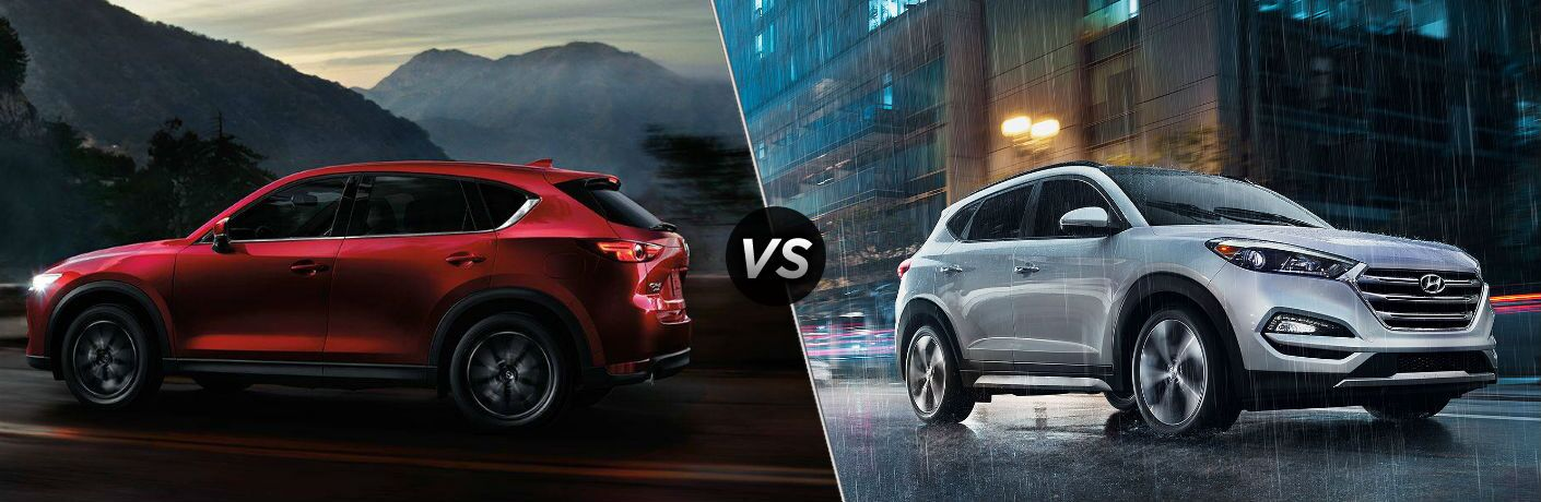 "Driver side exterior view of a red 2018 Mazda CX-5 on the left ""vs"" a passenger side exterior view of a gray 2018 Hyundai Tucson on the right"