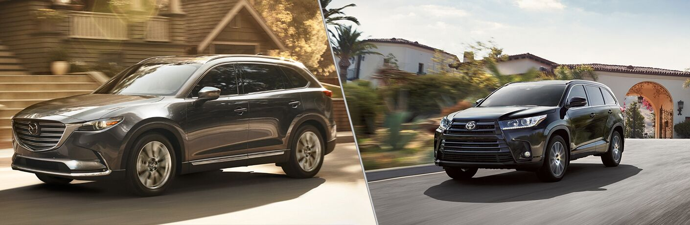 "Driver side exterior view of a gray 2018 Mazda CX-9 an the left ""vs"" driver side exterior view of a black 2018 Toyota Highlander"