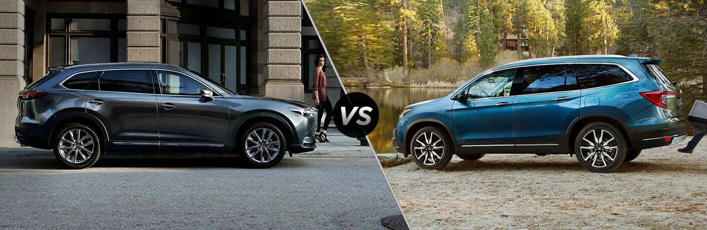 "Passenger side exterior view of a gray 2019 Mazda CX-9 on the left ""vs"" driver side exterior view of a blue 2019 Honda Pilot on the right"