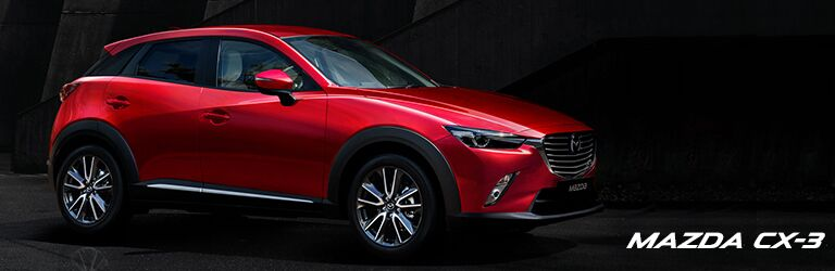 red 2019 Mazda CX-3 with wording in bottom right corner