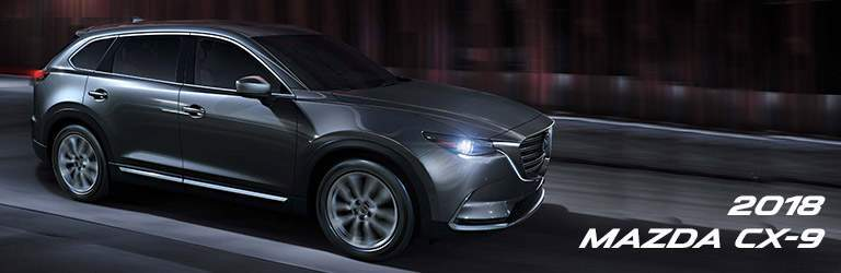 Passenger side exterior view of a gray 2018 Mazda CX-9