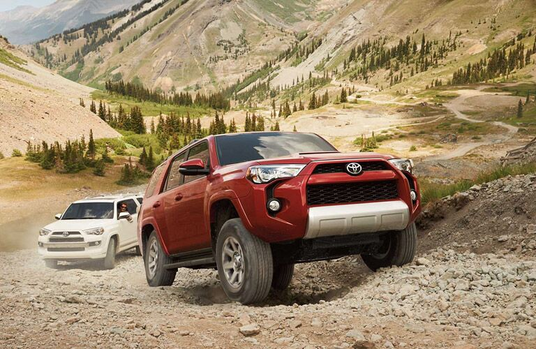 A couple of 2016 Toyota 4Runners on a steep trail