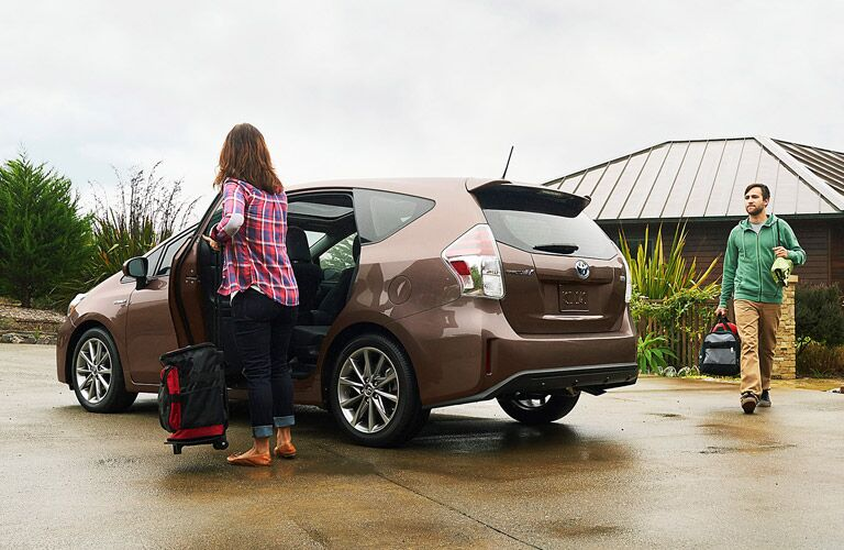 2016 Toyota Prius v being loaded with luggage
