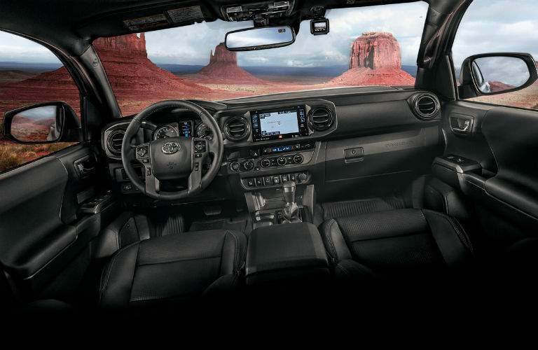 Interior Cabin of the 2018 Toyota Tacoma with focus on the screen and steering wheel
