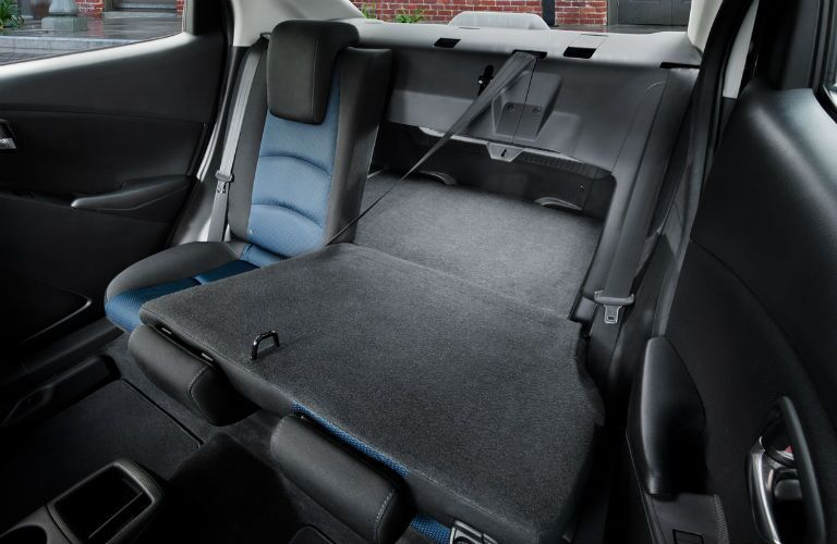 Back seat of the 2018 Toyota Yaris iA with the 60/40 split seating folded down to extend the cargo space
